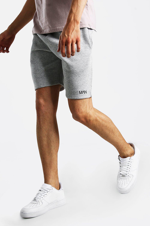 Boohoo | Оригинальные шорты с принтом MAN средней длины из джерси | Clouty