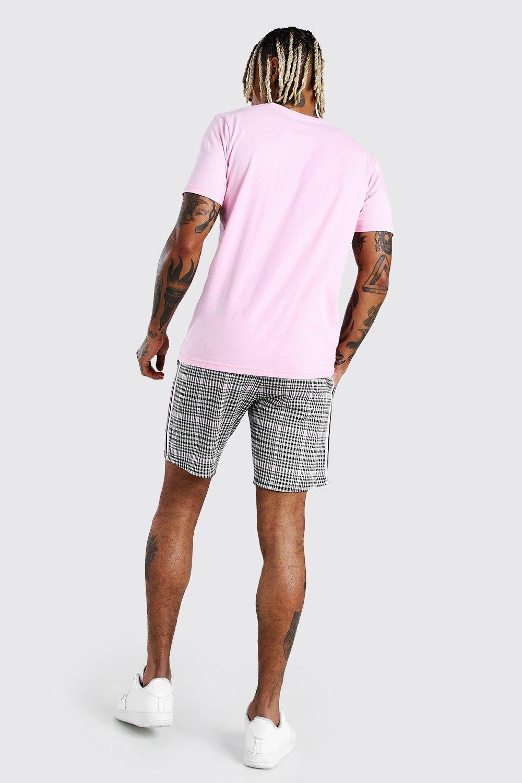 Boohoo | Фирменные шорты средней длины с тесьмой и резинкой на талии с надписью MAN | Clouty