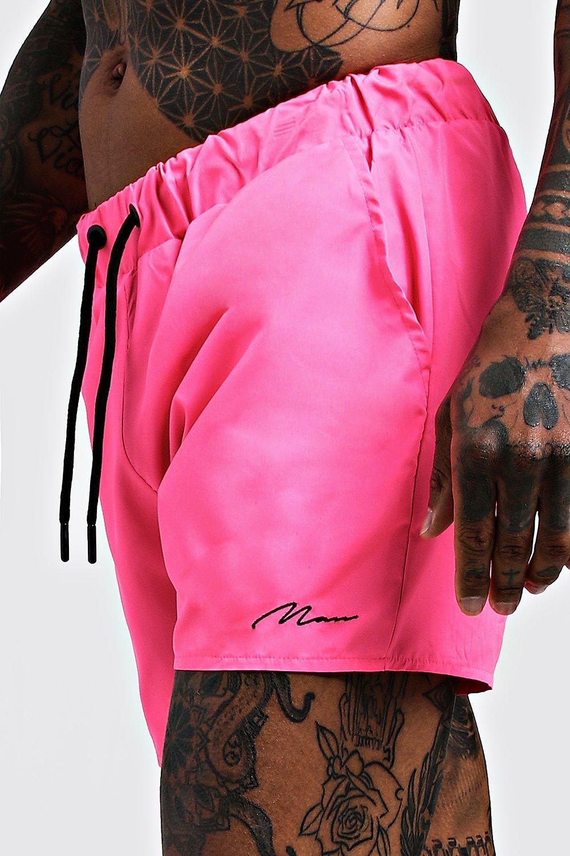 Boohoo | Фирменные шорты для плавания средней длины из коллекции MAN | Clouty