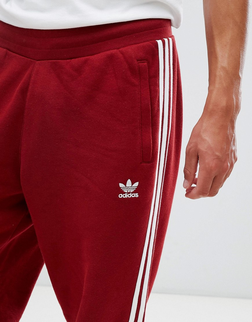 adidas Originals | Красные джоггеры с 3 полосками adidas Originals adicolor CW2428 - Красный | Clouty