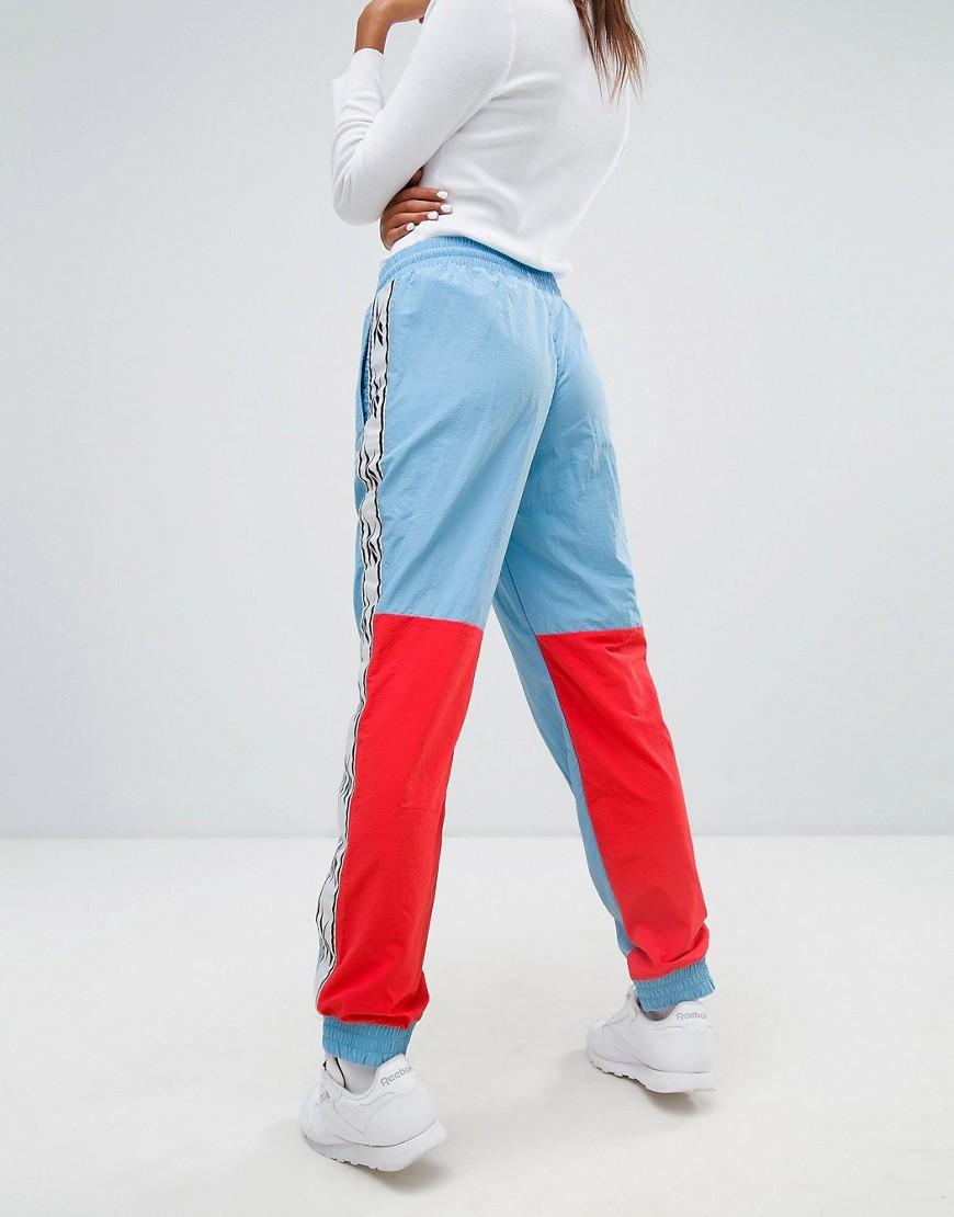 REEBOK | Синие спортивные штаны Reebok Classics Lost & Found - Синий | Clouty