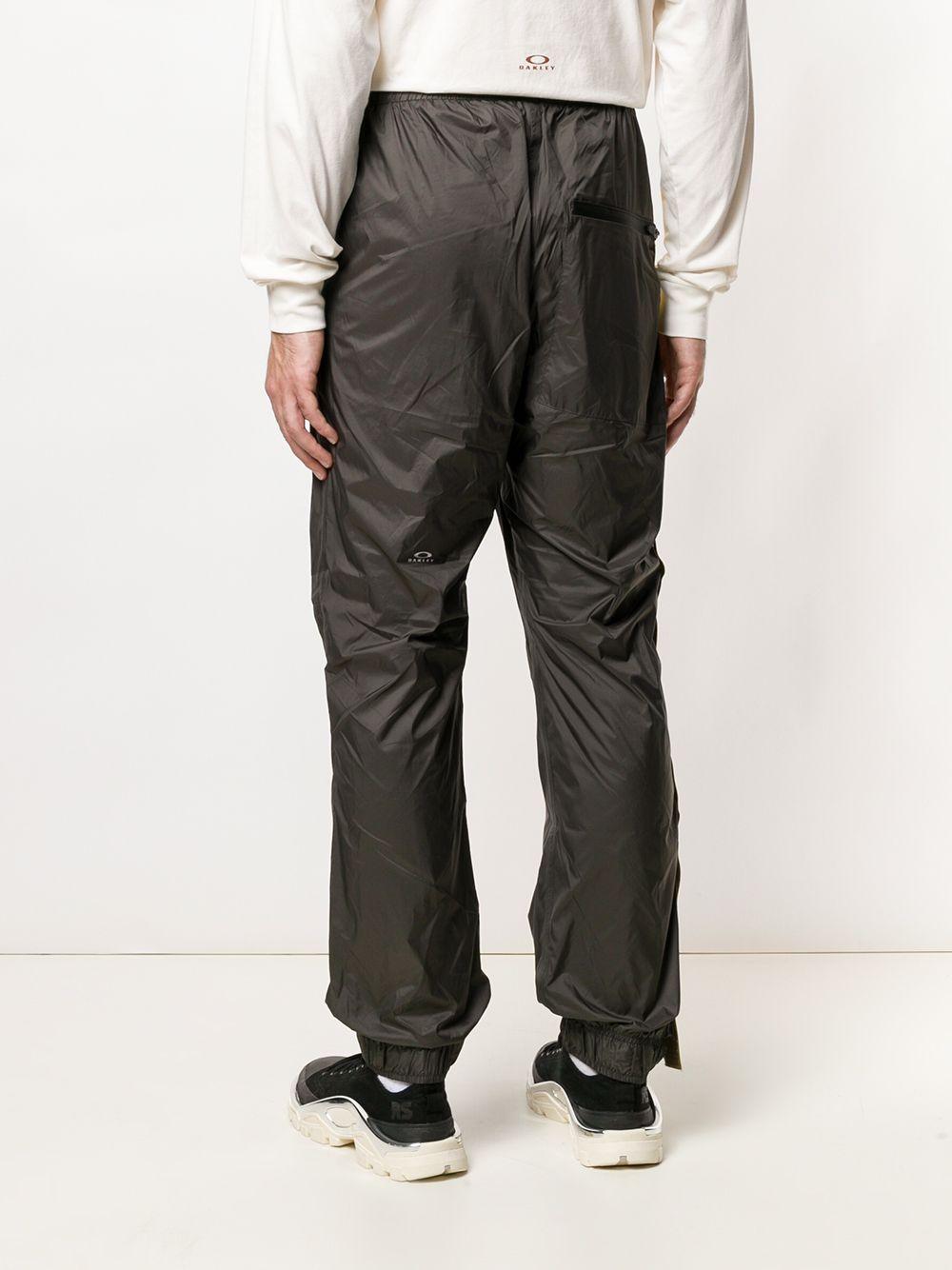 Oakley By Samuel Ross | спортивные брюки с боковыми полосками | Clouty