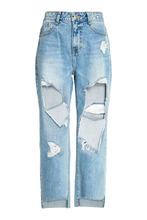 Фото Голубые джинсы с прорезями