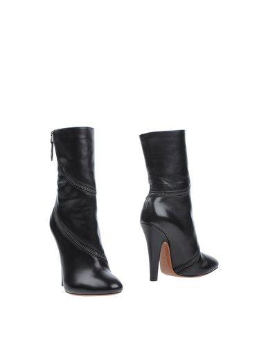 ALAÏA   Черный Женские черные полусапоги и высокие ботинки ALAIA Без аппликаций   Clouty