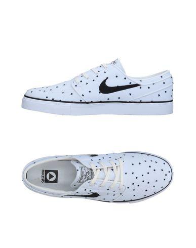 NIKE | Белый Мужские белые низкие кеды и кроссовки NIKE парусина | Clouty