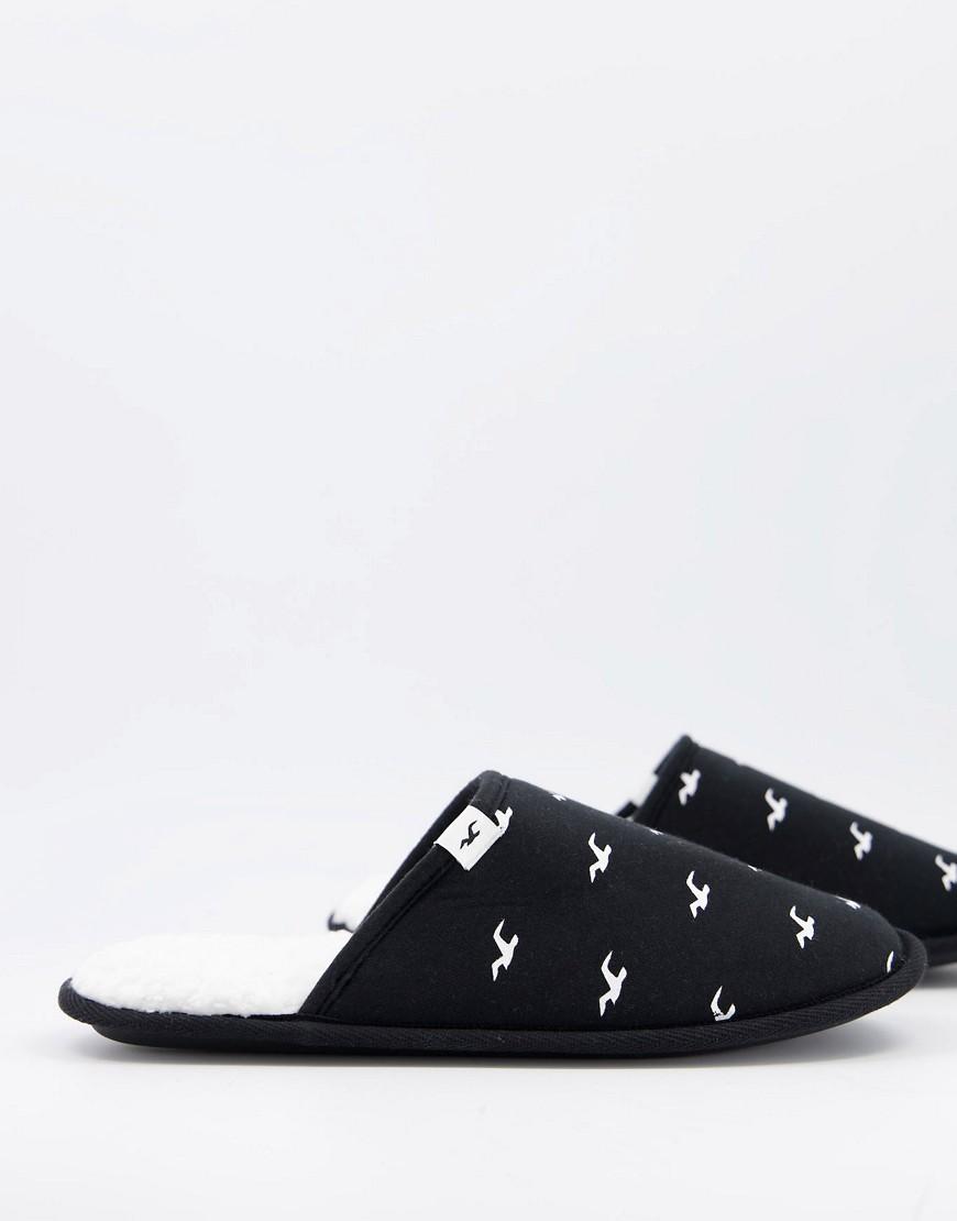 Hollister   Черные слиперы с флисовой подкладкой и сплошным принтом логотипа Hollister-Чepный цвет   Clouty
