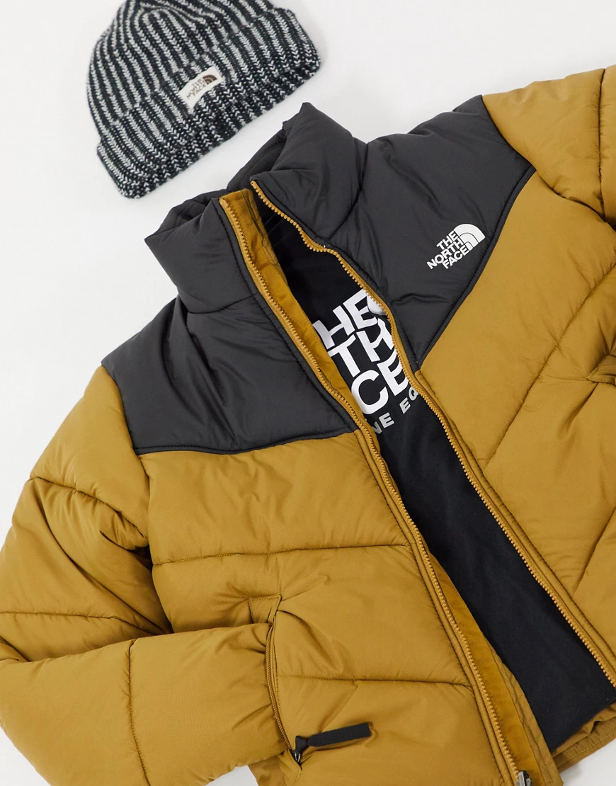 The North Face   Дутая куртка цвета хаки The North Fасе-Зеленый   Clouty