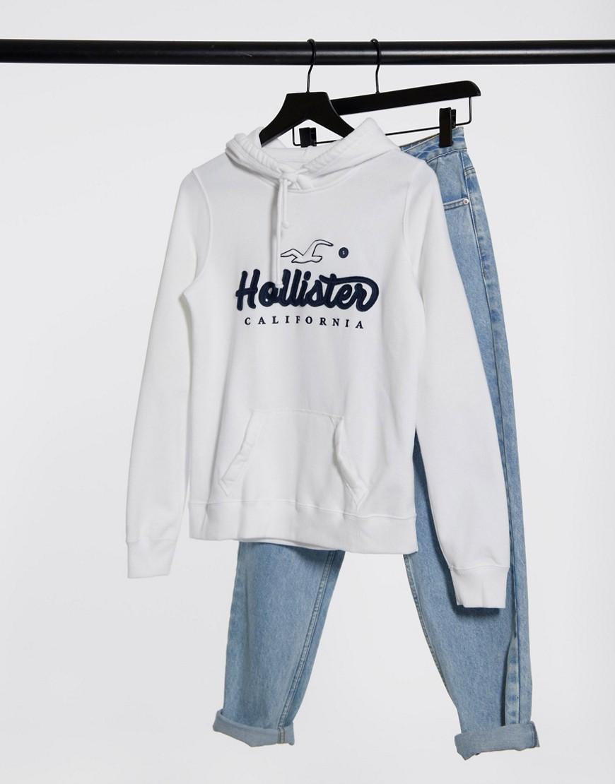 Hollister | Худи белого цвета с логотипом Hollister-Бeлый | Clouty