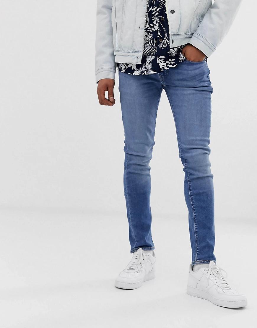 Levi's   Супероблегающие джинсы с заниженной талией Levi's 519 - cedar light mid overt-Синий   Clouty