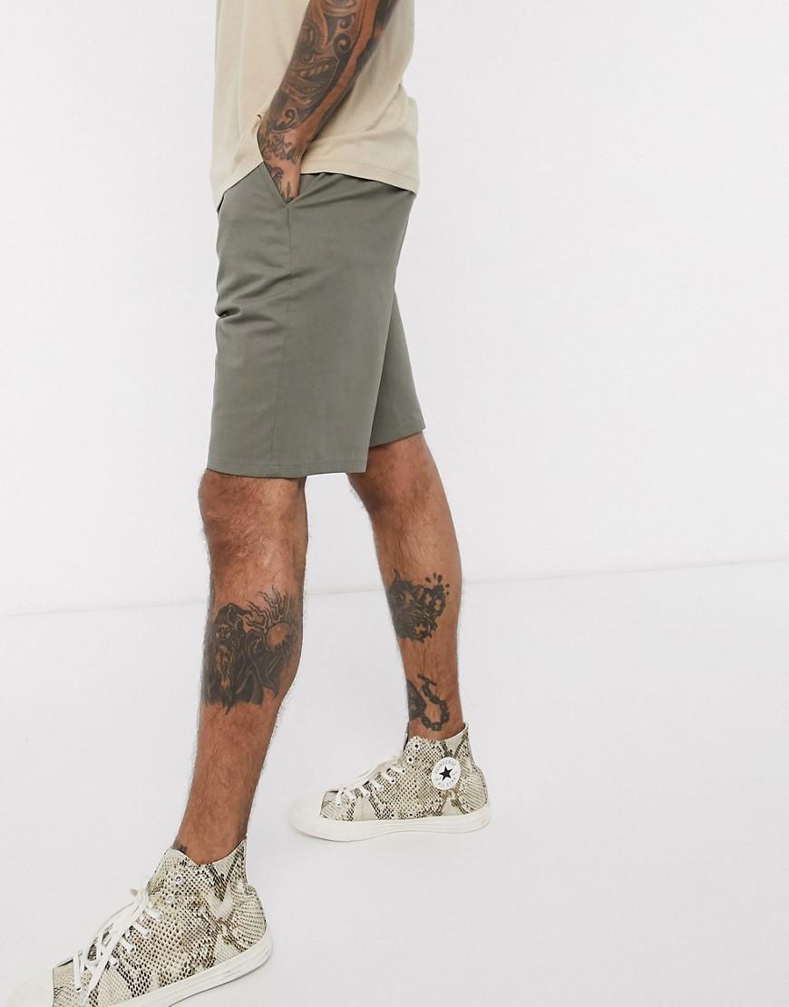 ASOS DESIGN | Свободные шорты чиносы цвета хаки ASOS DЕSIGN-Зеленый | Clouty